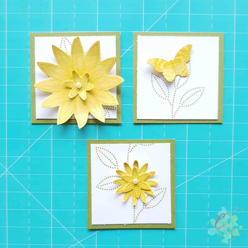 Die Quadrate dekoriert mit den Blumen und dem Schmetterling aus dem Stempelset So Dankbar von Stampin' Up!