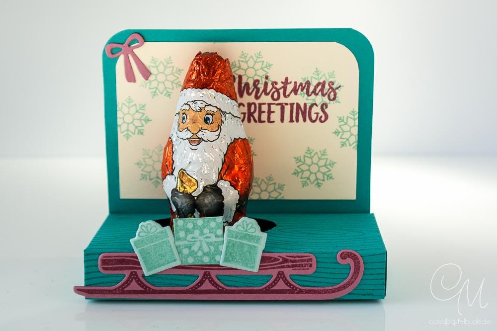Geschenkverpackung für einen kleinen Weihnachtsmann in den Farben Bermudablau, Aquamarin und Zarte Pflaume von Stampin' Up!, Ansicht von vorne