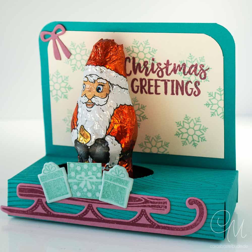 Geschenkverpackung für einen kleinen Weihnachtsmann in den Farben Bermudablau, Aquamarin und Zarte Pflaume von Stampin' Up!, Seitenansicht